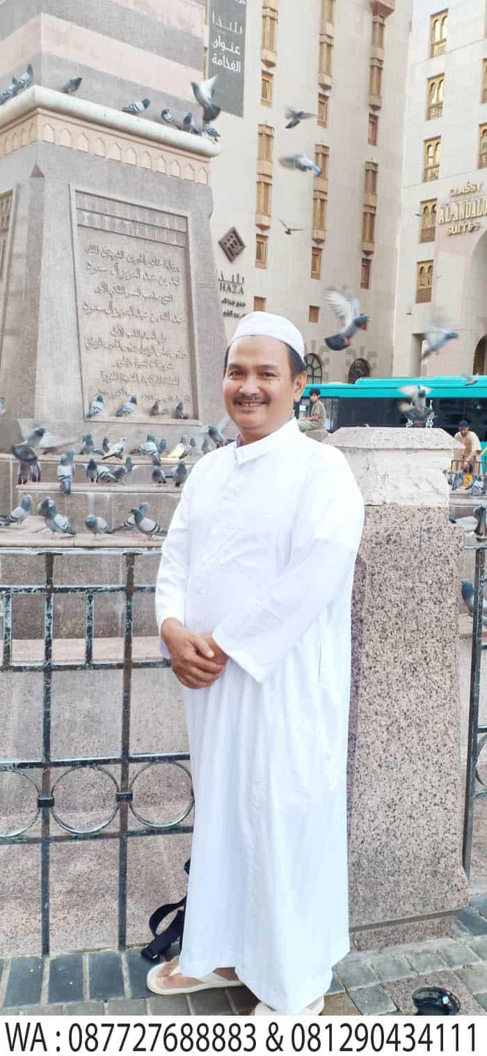 jam dan burung dara di masjid madinah